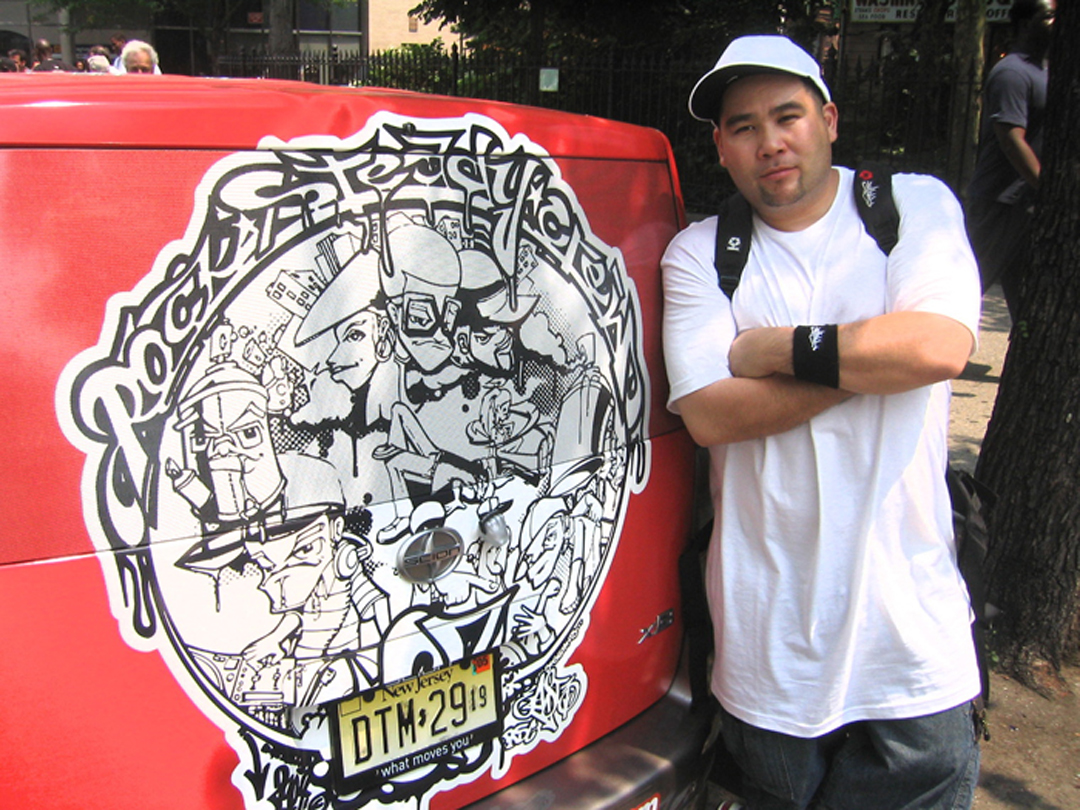 Rock Steady Crew 27th Anniversary art by East 3 posing by Scion wrapped car
